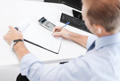 Businessman with notebook and calculator Stock Images