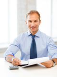 Businessman with notebook and calculator Stock Image
