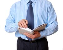 Businessman with notebook and pen writing Stock Photography