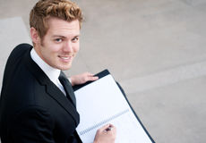 Businessman with notepad Royalty Free Stock Photos