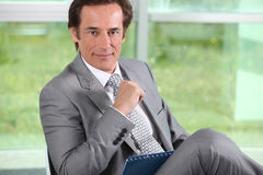 Businessman with notepad. Royalty Free Stock Photography