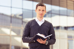 Businessman with notepad and pen Royalty Free Stock Images