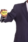 Businessman with a notiz in hand next Stock Photography