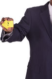 Businessman with a notiz in hand punctuation Royalty Free Stock Photography