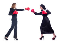 The businessman and nun boxing isolated on white Royalty Free Stock Photography
