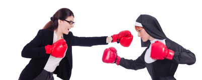 The businessman and nun boxing on white Stock Images