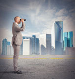 Businessman observes from a distance Stock Photos