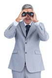 Businessman observing through binoculars Royalty Free Stock Image
