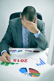 Businessman observing a chart with a downward trend during 2015 Royalty Free Stock Image