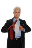 Businessman oepening his shirt Royalty Free Stock Photography