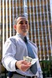 Businessman offer money Stock Photo
