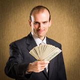 Businessman offer money Royalty Free Stock Photos