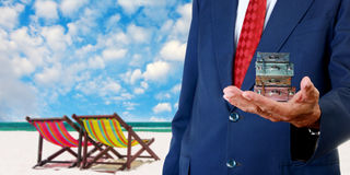 Businessman offer the summer trip Stock Images