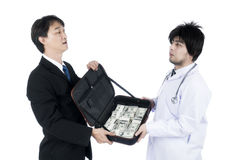 Businessman offered a lot of money to the doctor do corrupt Royalty Free Stock Images