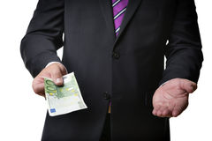 Businessman offering banknote Stock Photo