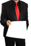 Businessman offering blank document Stock Images