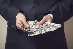 Businessman offering bribe Royalty Free Stock Image