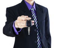 Businessman offering a car key Royalty Free Stock Images