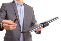 Businessman offering contract documentation. Focus on hand stock image