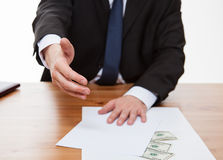 Businessman offering a cooperation and money Royalty Free Stock Images