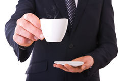 Business man offering cup of coffee. Stock Image