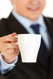 Businessman offering cup of coffee. Closeup. Stock Images