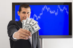 Businessman offering dollar Stock Photo