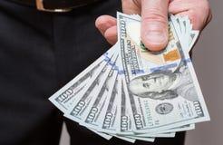 Businessman offering dollars Stock Photo