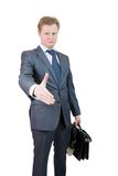 Businessman offering a handshake Royalty Free Stock Images