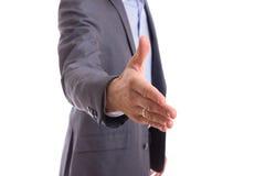 Businessman offering for handshake. Focus on hand Stock Photos