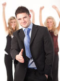 Businessman offering a handshake. At camera Stock Photography