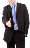 Businessman offering a handshake. At camera Royalty Free Stock Photo