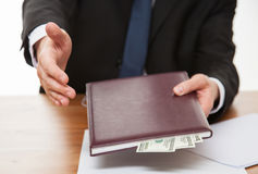 Businessman offering a handshake and bribe Stock Photography