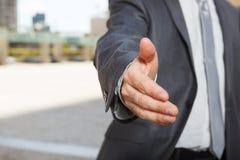 Businessman offering for handshake Royalty Free Stock Image
