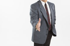 Businessman offering for handshake Stock Photography
