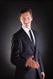 Businessman Offering Handshake Stock Photography