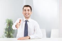 Businessman offering for handshake stock photos
