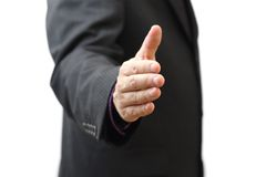 Businessman offering handshake to you.  Royalty Free Stock Image