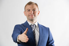 Businessman offering his hand Royalty Free Stock Photos