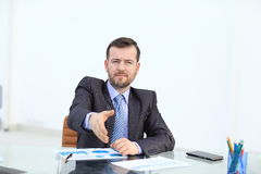 Businessman offering his hand for handshake. Greeting or congratulating gesture. Business meeting and success Royalty Free Stock Images