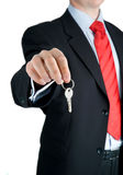 Businessman offering key to Your dream ... Well-dressed man offering key to Your dream Royalty Free Stock Photo