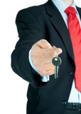 Businessman offering key to Your dream . Well-dressed man offering key to Your dream Stock Image