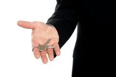Businessman offering keys, closeup shot Stock Image