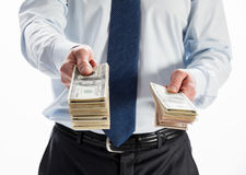 Businessman offering money to you Stock Images
