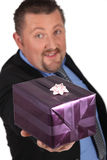 Businessman offering gift Stock Images