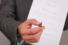 Businessman offering a pen to sign a contract , giving pen to partner to sign contract. personal banker  giving pen to Client sign Royalty Free Stock Photos