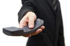 Businessman is offering phone Stock Photos