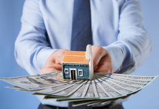 Businessman offering to buy a new house Royalty Free Stock Photos