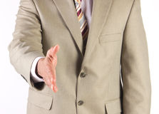 Businessman offering to shake hands. Corporate businessman extending hand to greet and welcome executives Royalty Free Stock Image