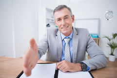 Businessman offering to shake hands Royalty Free Stock Photography
